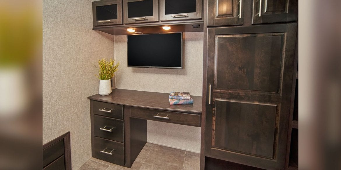 RV desk with cabinets above and below. Jayco North Point fifth Wheel