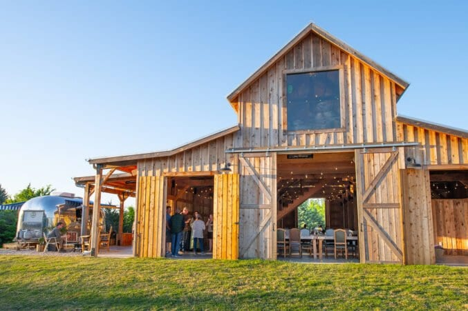 restaurant and event center in a wood pole barn plus a vintage airstream bar